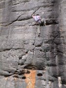 "Owen leading the wickedly pumpy sport route ""Terminal Insomnia"", grade 22"